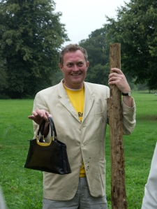 Robin Hellier holding Madam Mayor's handbag while she planted a tree