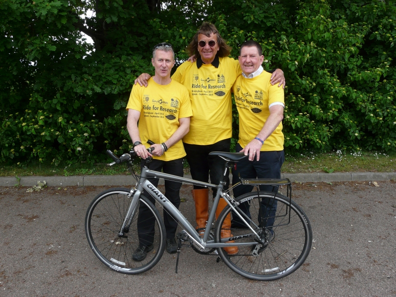 Russell Ball (left) and Mick Boddy (right), trustees,  present Claus Mattheck with one of the distinctive yellow Ride for Research tee shirts