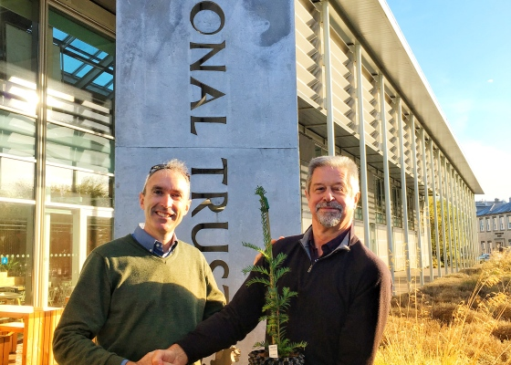 Fund4Trees trustee Gabriel Hemery receives a cutting from the Ankerwycke Yew from Ray Hawes of The National Trust